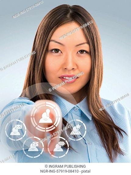 Asian business woman pressing social media icon