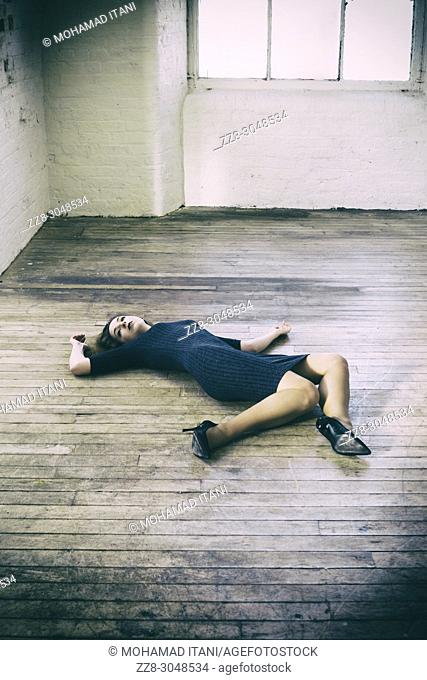 Dead woman laying down on the floor
