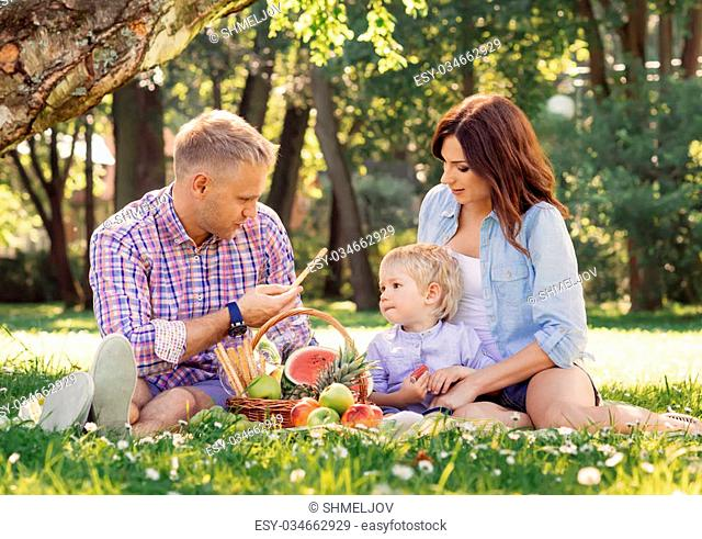 Family being together on vacation having a picnic on fresh air
