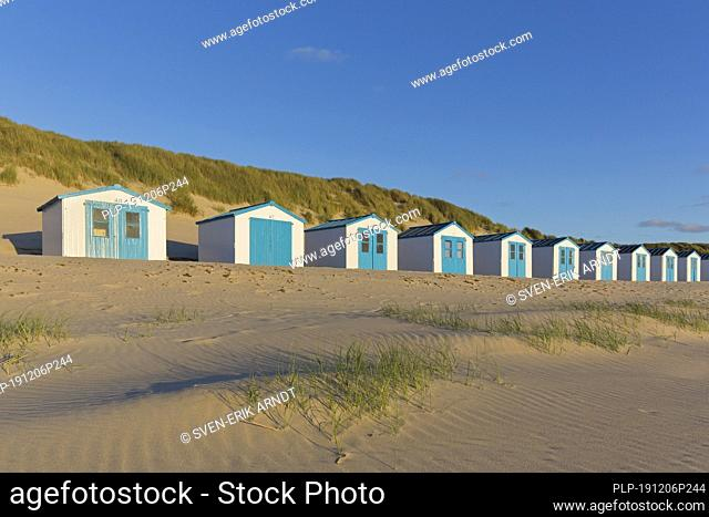 Row of blue and white beach cabins on Texel, West Frisian Island in the Wadden Sea, Noord-Holland, the Netherlands