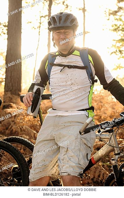 Portrait of smiling Caucasian man on mountain bike