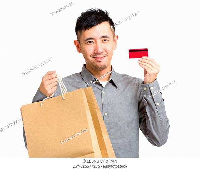 Asian Man hold with shopping bag and credit card