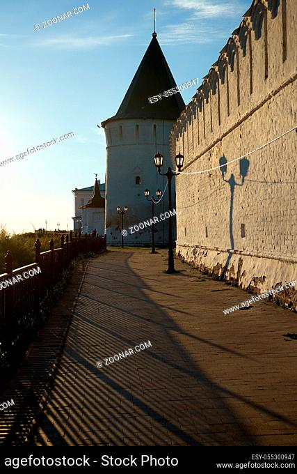 The view of the South stone defensive wall and South-eastern round tower of Tobolsk Kremlin in the sunset light. Tobolsk. Russia