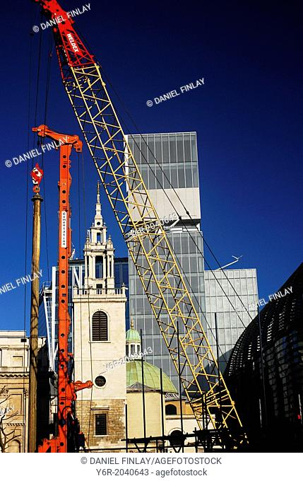 City of London financial centre view - building work, ancient churches and avant garde architecture on a sunny day