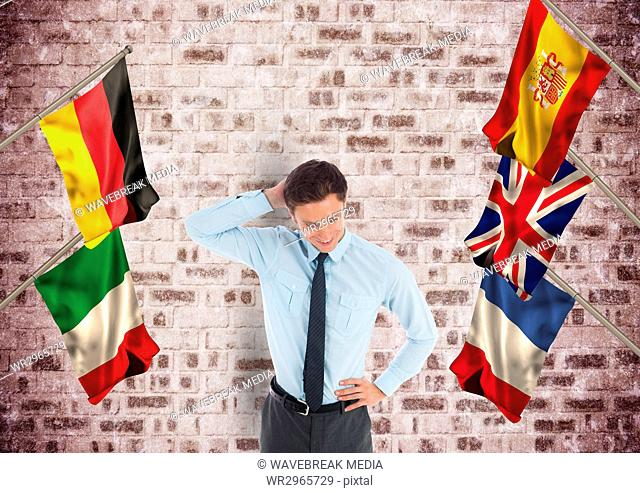 main language flags around business young man. Bricks wall background