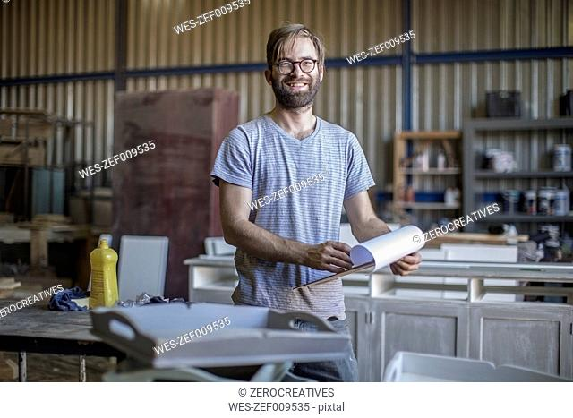 Portrait of smiling carpenter in workshop
