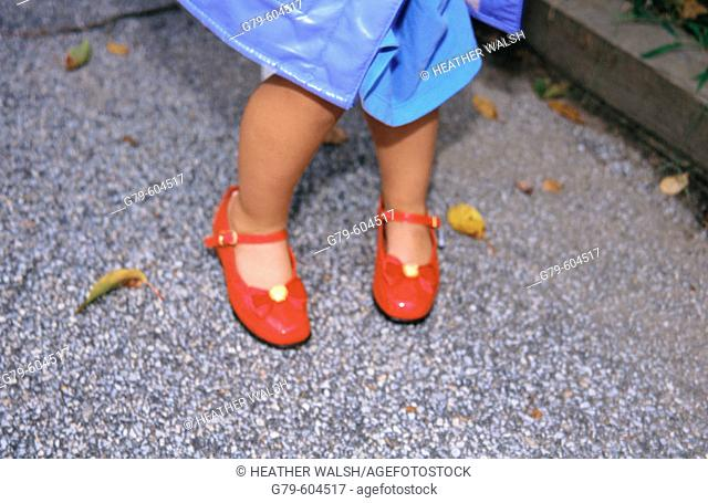 Close up young girl with red shoes on