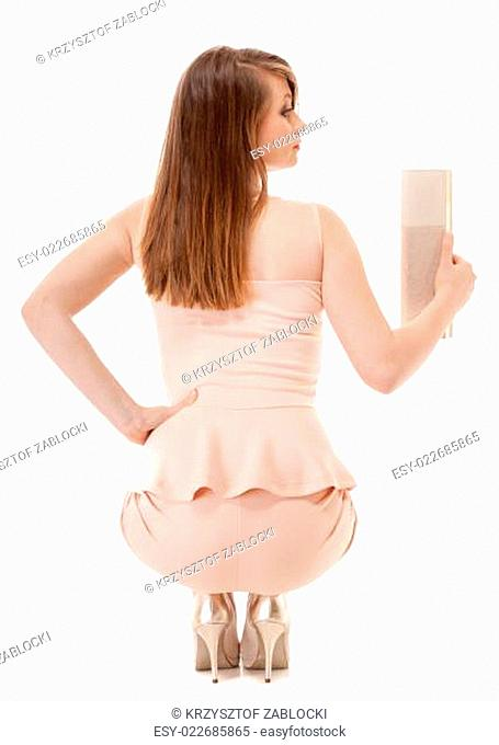 beautiful young fashion woman with handbag isolated