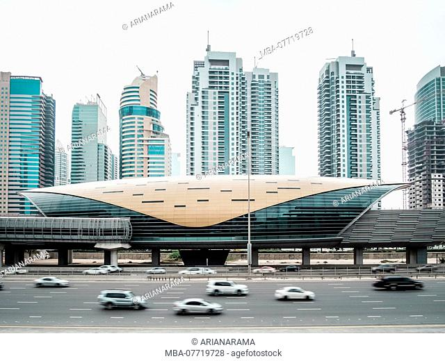 Futuristic building of Dubai metro station and highway in Dubai, United Arab Emirates
