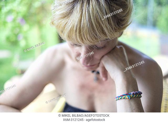 Portrait of mature woman, hand on cheek