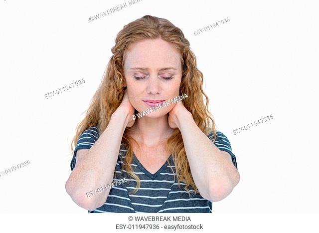 A blonde woman having neck pain