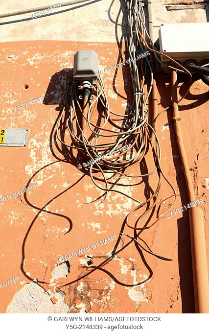 tangled electrical wires cables on wall in rome italy