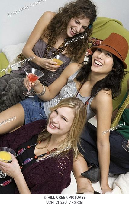 Young women drinking martinis