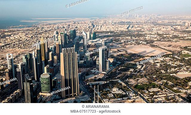 Dubai downtown afternoon scene. Top view from above with skyscrapers of Sheikh Zayed road. Panorama
