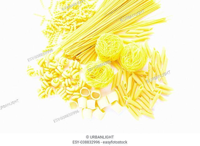 Organic yellow pasta on a white background