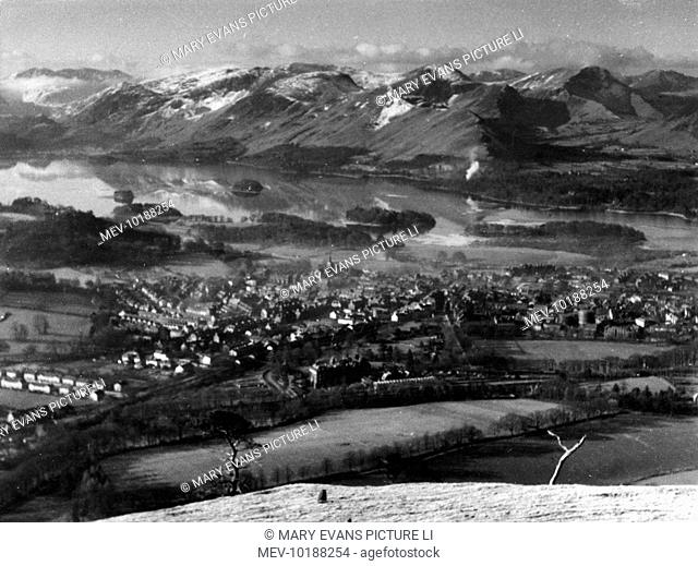 A winter's day view, overlooking Keswick, with Derwentwater beyond, seen from the slopes of Latrigg Mountain, Lake District, Cumbria, England