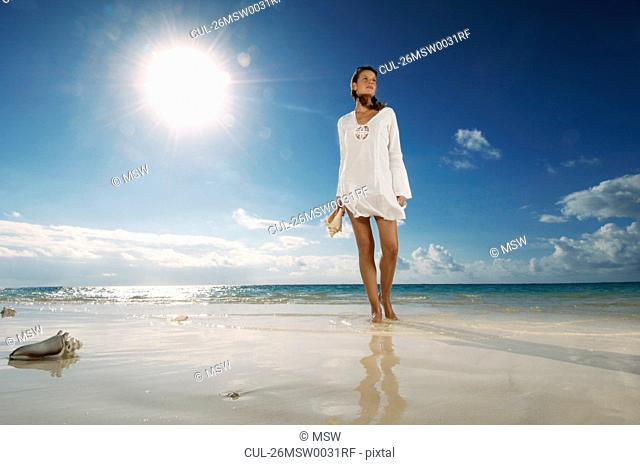 Woman walking on beach