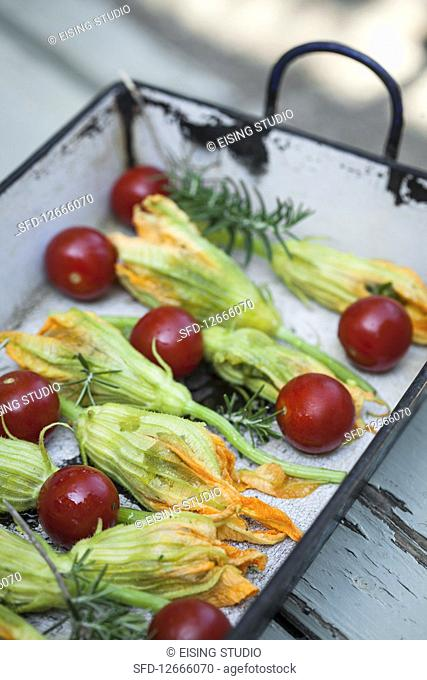 Stuffed courgette flowers with cherry tomatoes and rosemary