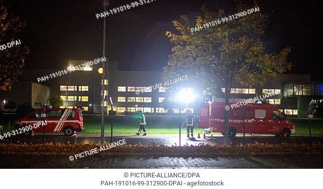 16 October 2019, Saxony-Anhalt, Haldensleben: Firefighters work on the premises of the parcel service Hermes. After the sudden death of two employees and the...