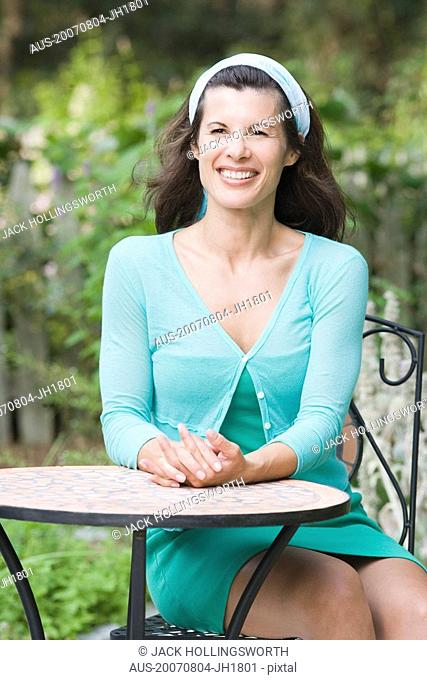 Portrait of a mature woman sitting at a table and smiling