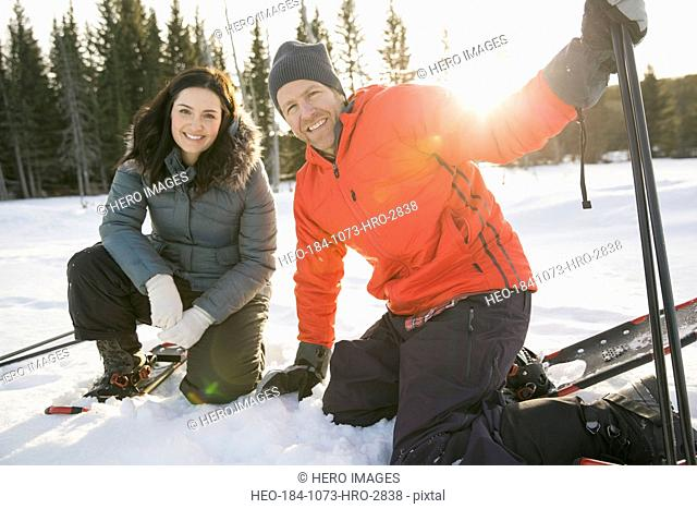 Portrait of couple outdoors in snowshoes
