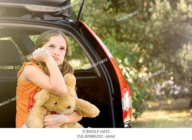 Sullen girl with teddy bear