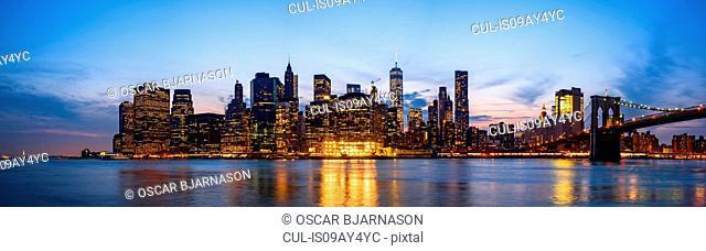 Panoramic cityscape of Manhattan Bridge and skyline at dusk, New York, USA
