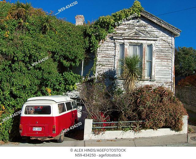 Run down old house with VW Kombi van