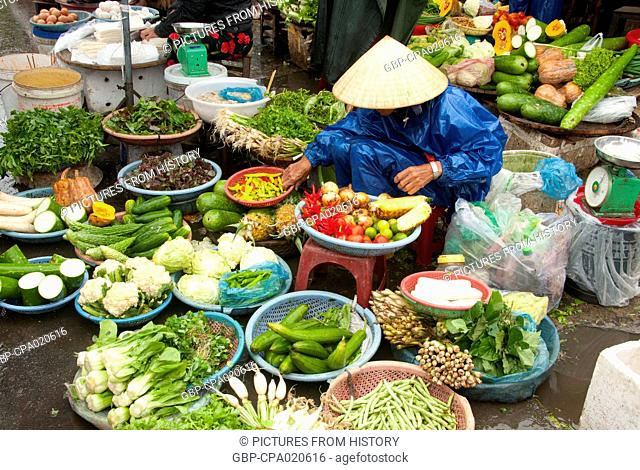 Vietnam: Fruit and vegetable vendor in a fresh market in Hue, central Vietnam