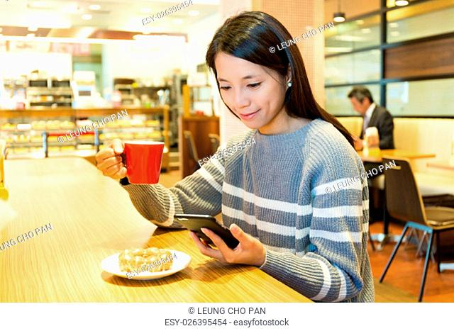 Woman enjoy drink of coffee at morning cafe