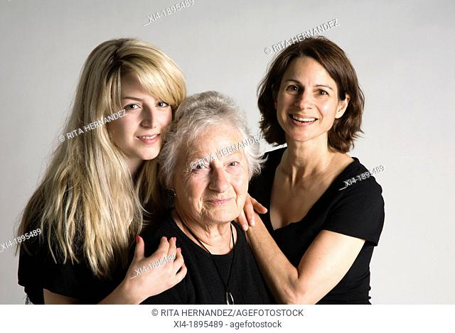 3 generation female portrait looking into the camera, white background