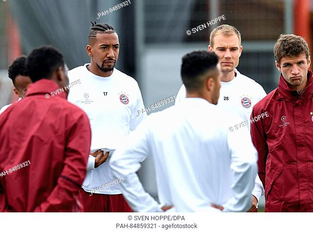 Bayern Munich's Jerome Boateng(l-r), Holger Badstuber and Thomas Mueller pictured at a training session in Munich, Germany, 18OCtober 2016