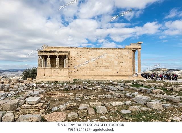 Many tourists visiting ancient Erechtheion, portico of the Caryatids - a miracle in Athens, Greece