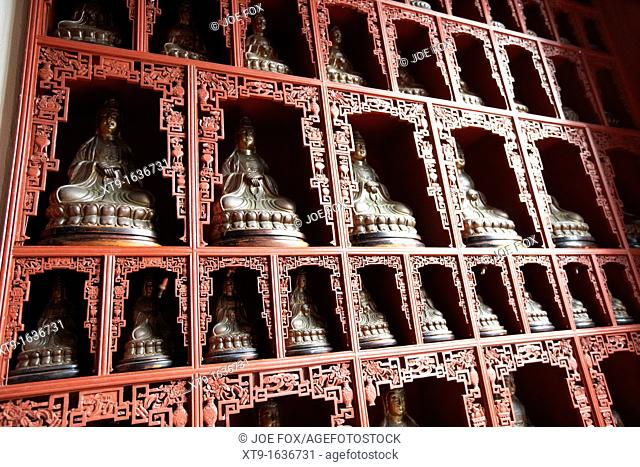 wall of temple full of small buddha statues po fook hill cemetery sha tin new territories hong kong hksar china asia