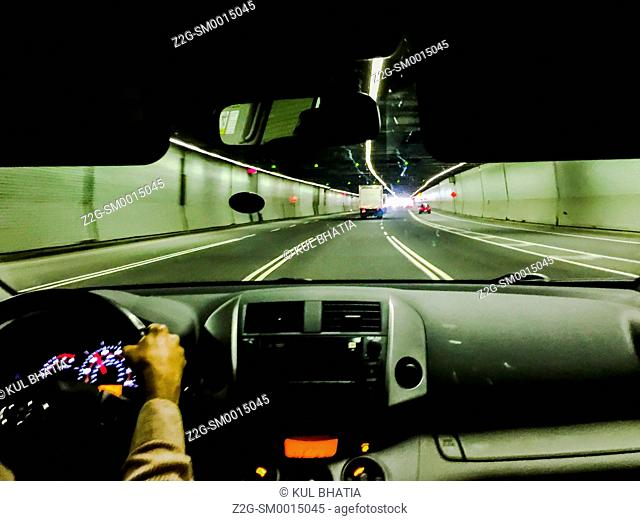 Driving through a tunnel, view from the back seat, Montreal, Quebec, Canada