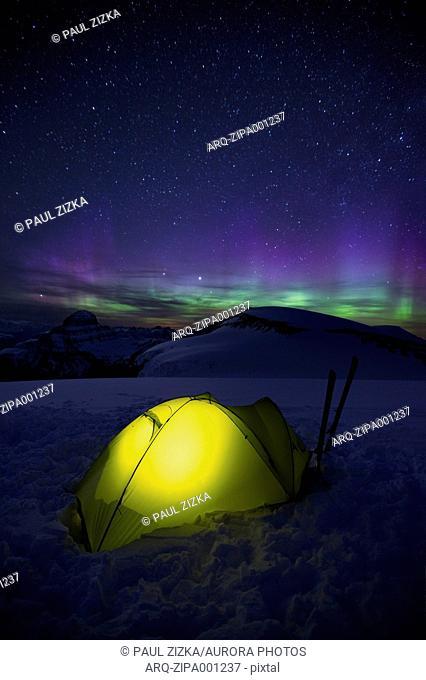 Illuminated Tent Under The Aurora Borealis
