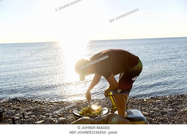 Man preparing food at sea