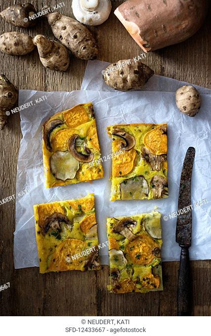 Vegan vegetable cake with turmeric, Jerusalem artichokes, sweet potatoes, spring onions and mushrooms