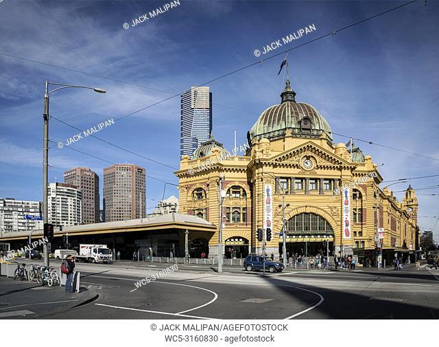 street scene outside landmark flinders street station in central melbourne australia
