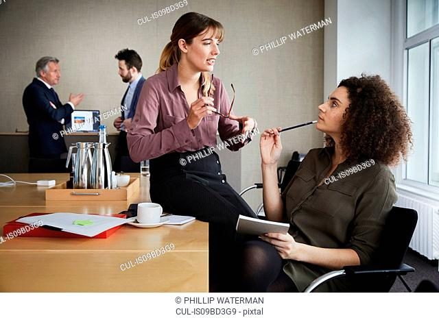 Colleagues in office chatting