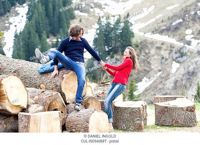 Mid adult couple fooling around, Wallberg, Tegernsee, Bavaria, Germany
