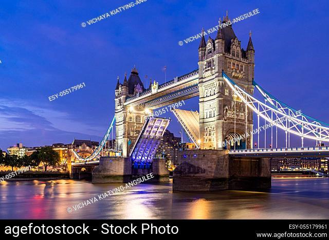 London Tower Bridge lifting up at Sunset dusk, London UK