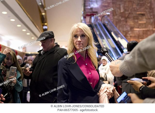 Trump campaign manager Kellyanne Conway is seen in the lobby of Trump Tower, posing for selfies with visitors while responding to questions posed by members of...