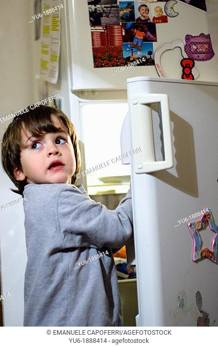 Child in front of the fridge