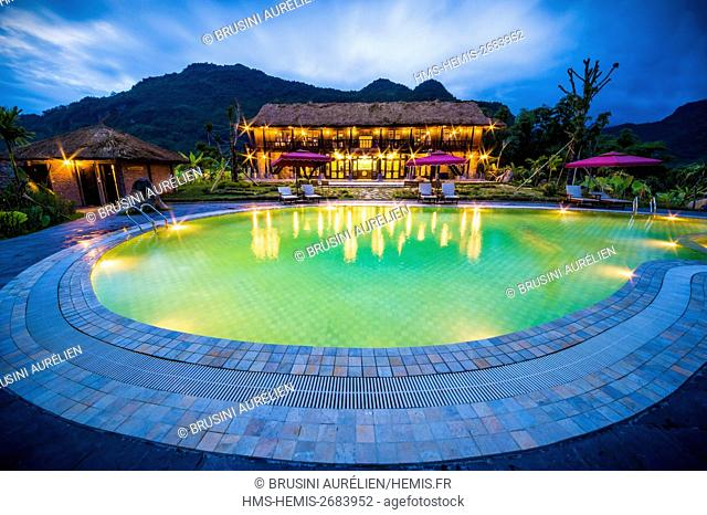 Vietnam, Mai Chau province, night view of the pool of Mai Chau Ecolodge, first luxury ecolodge of the country