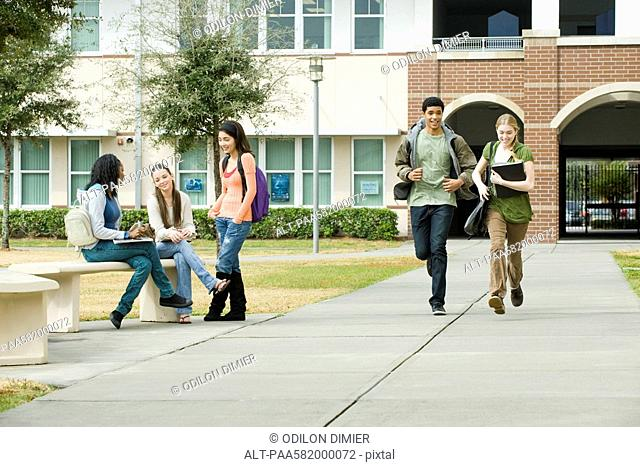 High school friends hanging out together on school campus