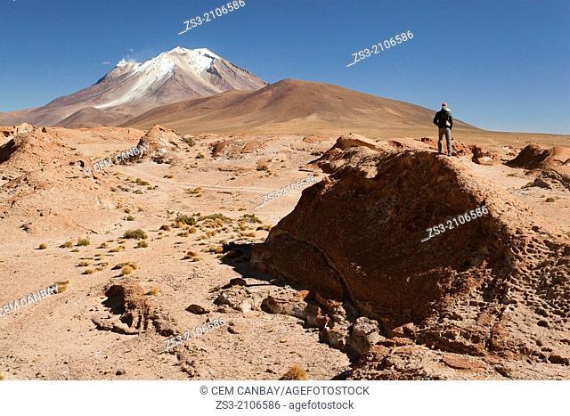 Tourist on the hill during a break, Salar de Uyuni, Southern Altiplano, Bolivia