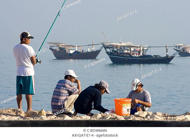 Men fishing at Al Wakrah port, Qatar