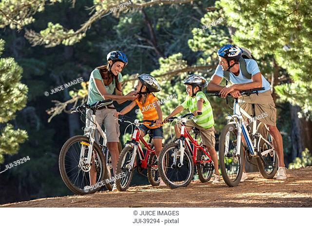 Family with mountain bikes in woods