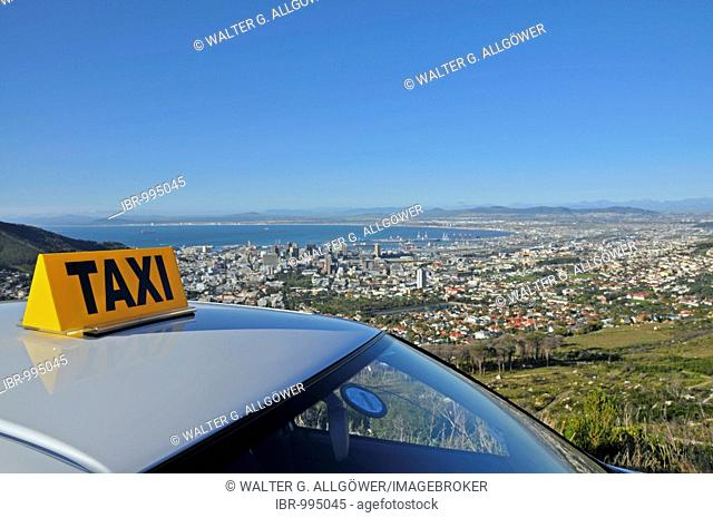 View over over a taxi roof onto Cape Town from the Table Mountain cable car base station, South Africa